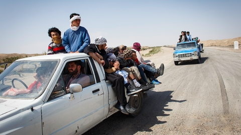 Afghans start their journey to Europe in trucks on this road in Afghanistan's Nimruz Province near the border of Iran in October 2015