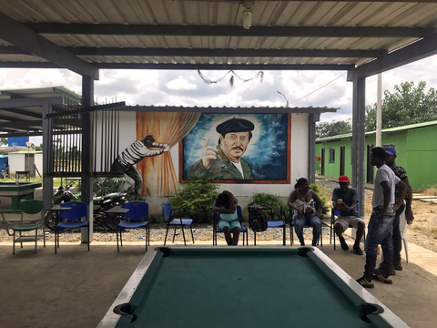 A mural of a FARC leader on the wall of a camp building