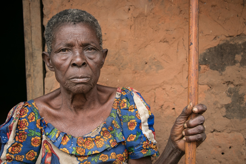 Galalela sits in front of her home in Kamanda, an area affected by the conflict in Kasai, DRC