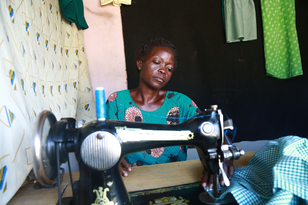 a woman at a sewing machine