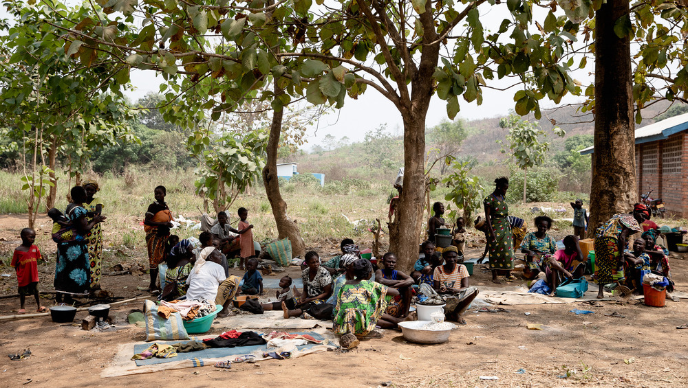 Displaced women and children sit under a mango tree in early February at a displacement camp in the town of Liton.