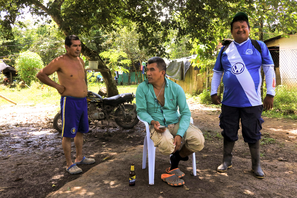 Juan de Jesus Monroy Ayala, 39, centre, a former member of the FARC elite guard, leads the cooperative.