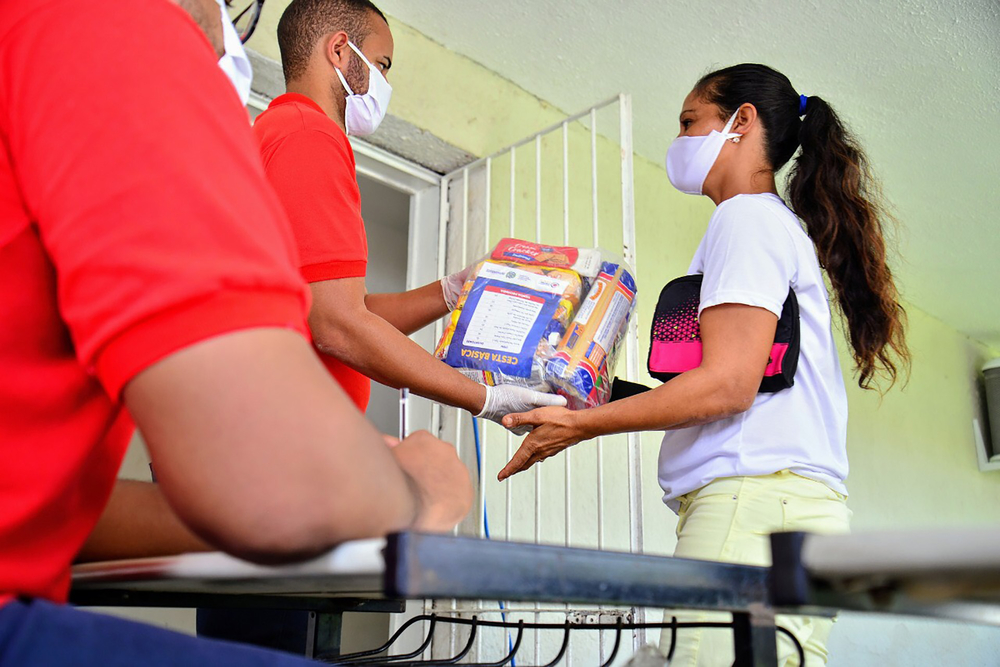People receive food packages in Pernambuco, Brazil