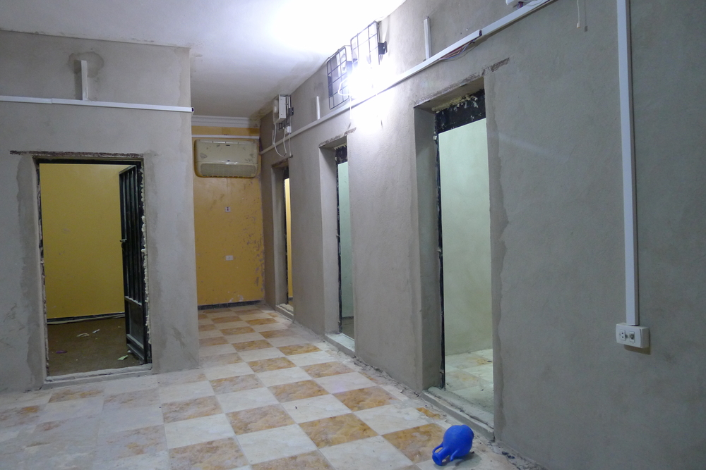 Four cell doors in an empty prison
