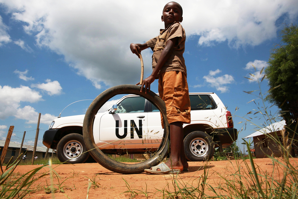 A child plays near a UN vehicle in Beni