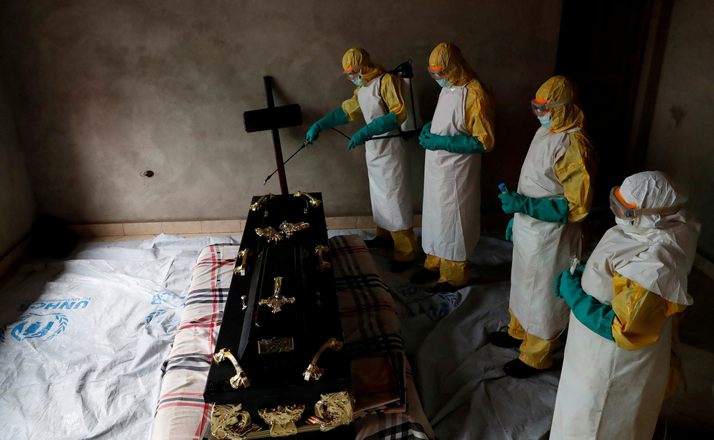 A healthcare worker sprays a room in Congo's North Kivu province
