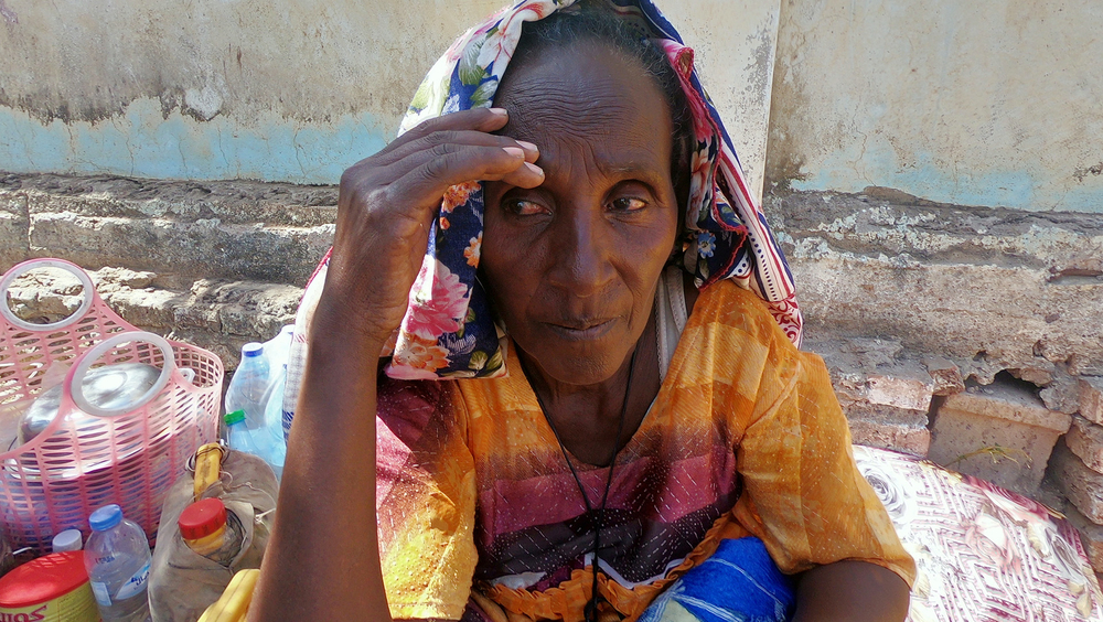 An Ethiopian woman who fled the ongoing fighting in Tigray region arrives in Hamdayet, a Sudanese border town. Almost 40,000 people have crossed the border seeking safety over the past two weeks