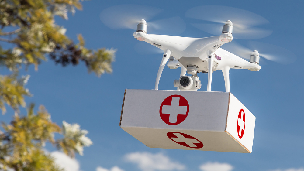 A drone carrying a first aid package