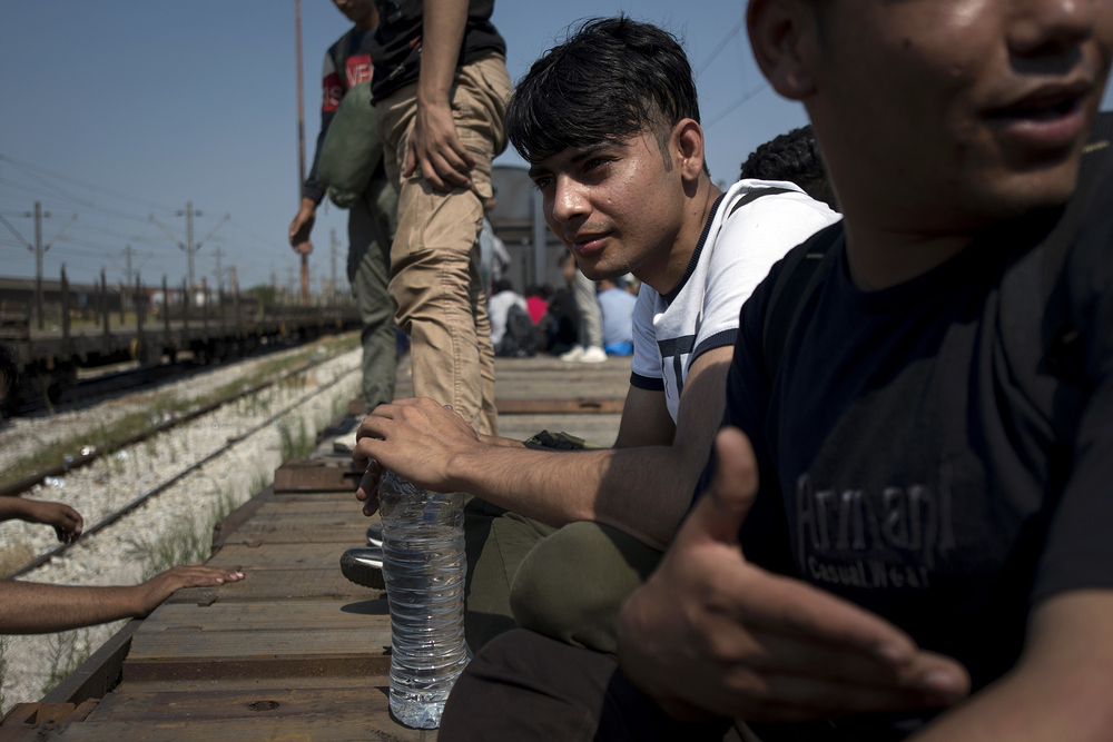 Sulaiman, a 16-year-old from Afghanistan, waits to hop on a train bound for the Greek-Macedonia border. He never saw staying in Greece as an option.
