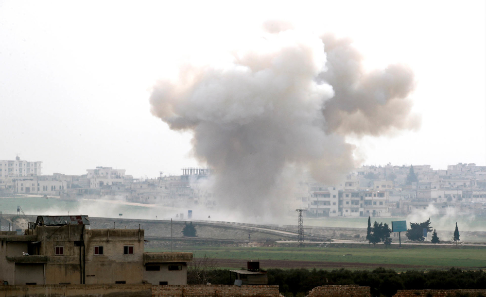 Smoke rises after an airstrike in Saraqeb in Idlib province, Syria, on 28 February 2020.