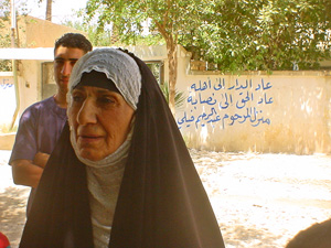 [Iraq] Umm Diaa recalls how her neighbour's home was confiscated.