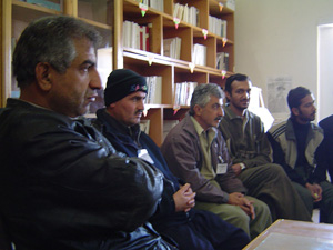 [Iraq] Members of the prison committee sitting in the library, with the Iranian Kurdish drug smuggler sitting closest to camera- Sulaymaniyah.
