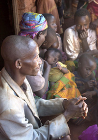 [Tanzania] Refugees waiting to be loaded onto the homeward bound trucks departure centre, Kanenbwa camp, Tanzania.