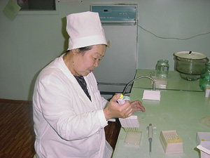 [Kyrgyzstan] A health worker in Osh checks blood for the HIV virus causing AIDS.