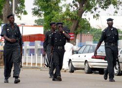 [Nigeria] Rioting in kano northern nigeria in May 2004 policemen deployed to keep peace patol the street of kano folowing continuing attack on christians by the muslims.