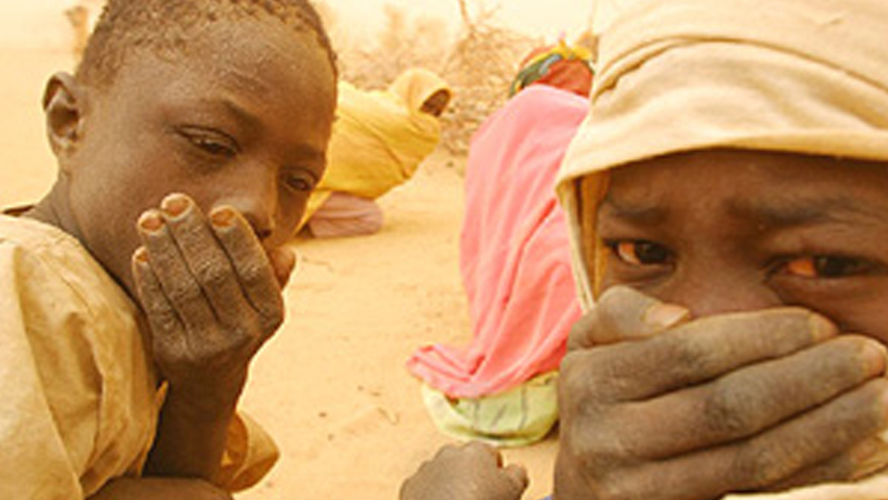 [Sudan] Darfurian boys and women shelter from the endless sandstorms along the Chad/Sudan border.
