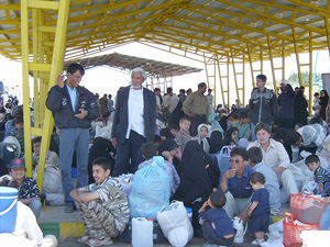 [Iran] Afghans wait before boarding buses for the border.