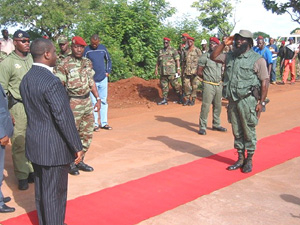 [Cote d'Ivoire] Rebel leader Guillaume Soro saluting a military commander in Korhogo, northern Cote d'Ivoire- July 2004.