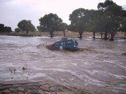 [Chad] World Food Programme (WFP) vehicle stuck in a flooded wadi in eastern Chad during the 2004 rainy season.