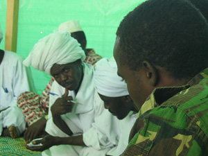 [Chad] Chadian gendarmes are introduced to leaders of Sudanese refugees from Darfur at Iridimi camp in eastern Chad, September 2004.