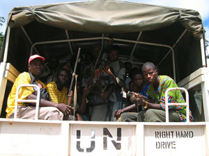 [Liberia] Fighters loyal to former Liberian president Charles Taylor are taken by UN military truck to a disarmament camp in Ganta, Nimba county, September 2004.