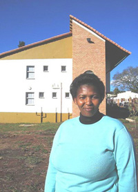[SWAZILAND] AIDS counselor Pholile Dlamini stands in front of the new centre.