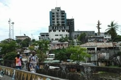 [Liberia] Monrovia is still a patchwork of shelled buildings and potholed roads