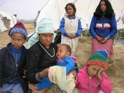 Bacchu Rokaya and her five children at a camp for internally displaced people in the village of Rajhena near Nepalgunj town, Nepal, 23 February 2005. Since the Maoist rebellion against the state began nine years ago, children's education has been one of t