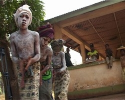 [Sierra Leone] These girls dance in their initiation ceremony that leads to their circumcision. If they refuse FGM  the will be discriminated against or ostracized from their community.