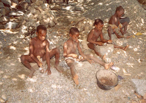 [Benin] Beninese children crushing stones into gravel at a quarry at Tchatchegou, north of the capital Cotonou, June 2005.