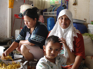 [Indonesia] Women and children were left particularly vulnerable in tsuanami-affected Aceh. Over 130,000 people were killed and more than half a million made homeless in the 26 December 2004 disaster. [Date picture taken: 10/15/2006]