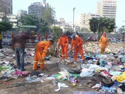 [Egypt] Workers clear the site of clashes between Sudanese asylum seekers in which at least 27 were killed. [Date picture taken: 12/31/2005]