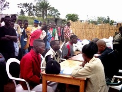 [DRC] Militiamen register at a disarmament site in Bunia, Ituri District.