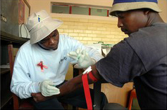 [South Africa] Taking The Initiative: But male AIDS treatment numbers are still lagging. [Date picture taken: 01/13/2005]