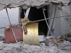 [Israel] A religious scroll in a bomb-damaged house in Kiryat Shmona. [Date picture taken: 08/20/2006]