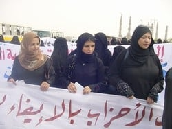 Women during a protest, Yemen, 17 September 2006. Yemeni women blame political parties for not supporting their candidature. Eight million people in Yemen live on less than  US$2 a day, making it the poorest country in the Arab world. With high illiteracy