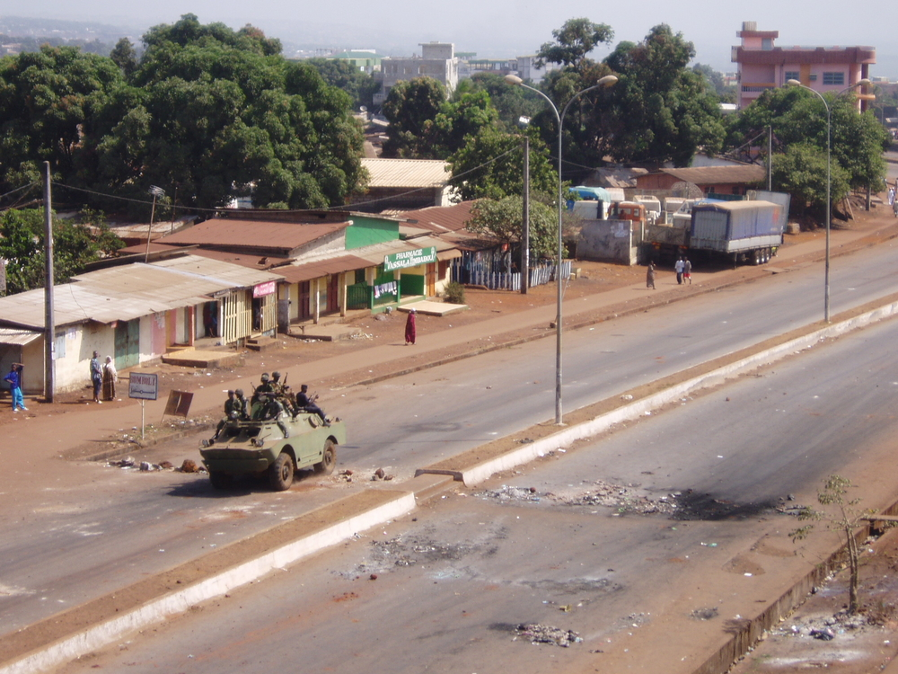 Armed soldiers move to stop  protests in Conakry, Guinea, 2 February 2007. After three weeks of demonstrations, in which security forces killed more than 40  protesters , Guinea's President Lansana Conté agreed to sign over some of his authority to an as