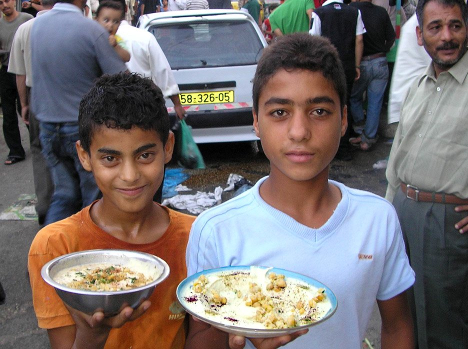 Palestinian children from the Balata refugee camp near Nablus hold plates of Hummus, Occupied Palestinian Territories, September 2006. The World Food Programme (WFP) has warned that almost half of all Palestinian face food insecurity.