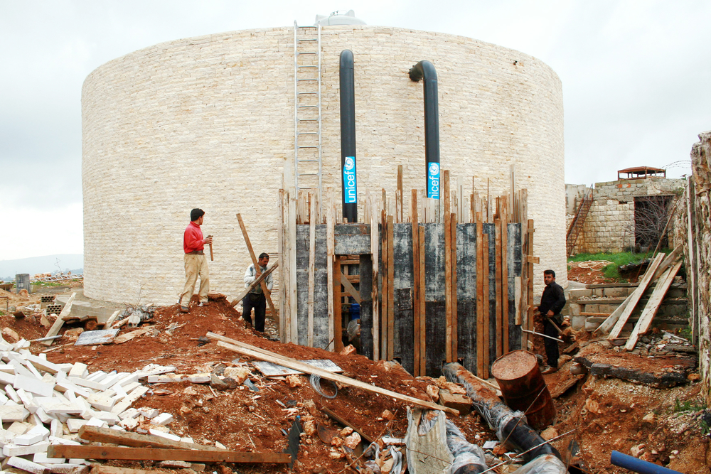 Khiyam's main 1,000-cubic-metre water tank, which was partially destroyed by Israeli fire, is now close to being rebuilt by UNICEF.