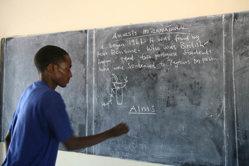 A teacher writes on a blackboard during a class at Ngoma School in Sikaneka village, Maamba district, Zambia, 28 February 2007. Lower education in Zambia is divided into three levels; primary, junior secondary and upper secondary. Higher education is very