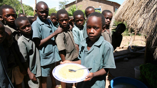 Students wait in line for lunch in Ngoma School, Sikaneka village, Maamba district, Zambia, 28 February 2007. Lower education in Zambia is divided into three levels; primary, junior secondary and upper secondary. Higher education is very limited and centr