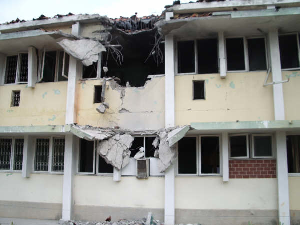 A hospital on the outskirts of Maputo, hit by a rocket from after a munitions dump exploded.