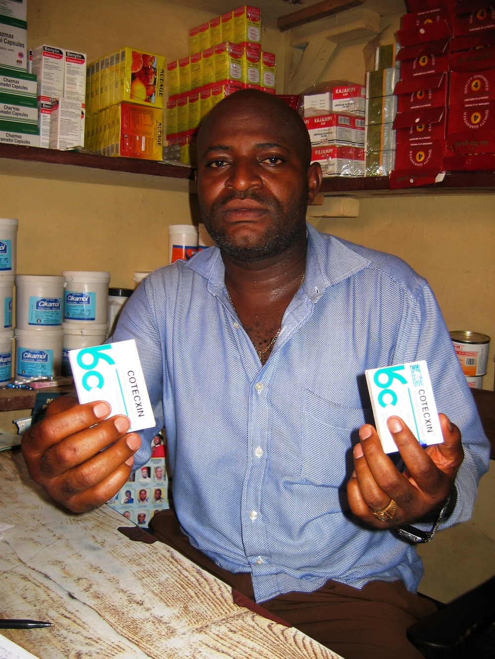 One of these packets of the anti-malaria medicine Cortecxin is fake, says Simon Okpoko, chairman of task force to stop fake drug at Ogbutu market, Enugu, Eastern Nigeria.