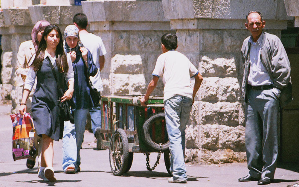A child porter working the busy streets of East Jerusalem.