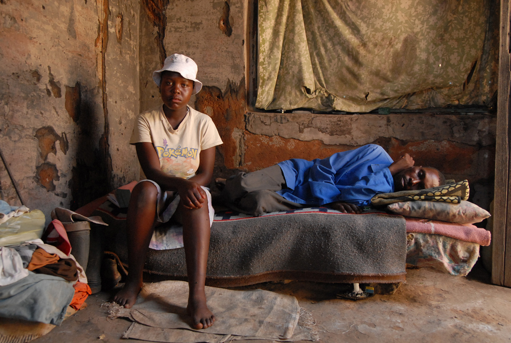 Mamaribe Hata-Hata, 17, and her father Ramarumo Hata-Hata, who has just tested positive for HIV. 20 June 2007. As her mother is dead, and her father's new partner also died two years ago, Mamaribe is the only one left to take care of him when he is sick