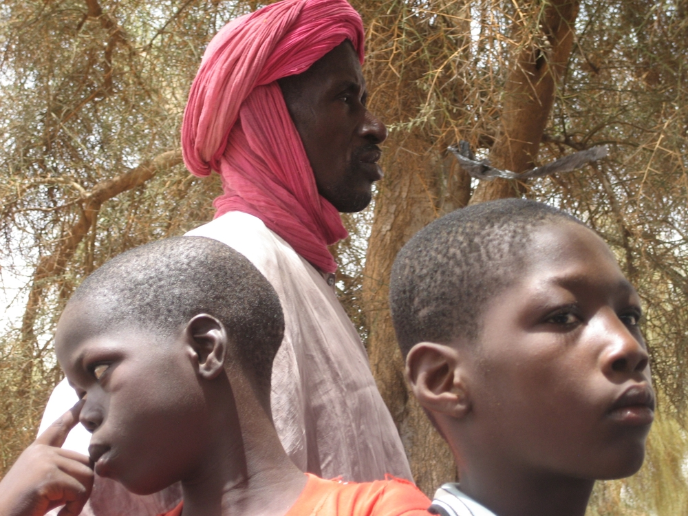 Mauritanian refugees at a community meeting in Ndioum, Senegal, to discuss their return home after 18 years.
