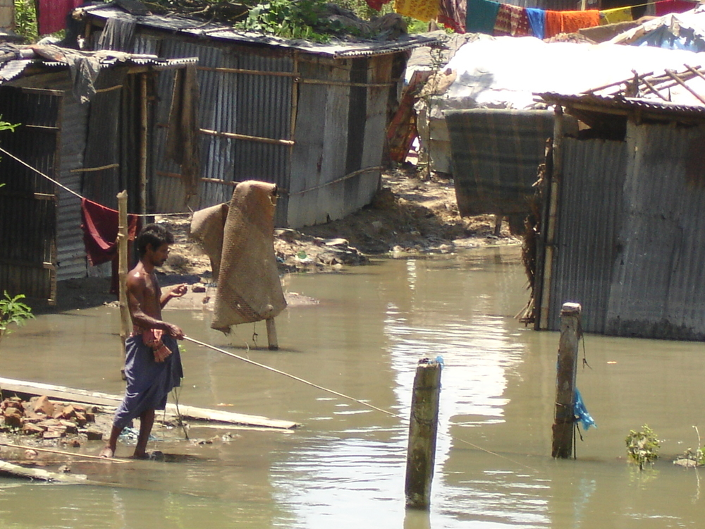Each year, low lying areas of Dhaka, the Bangladeshi capital, are flooded during the annual summer monsoon - affecting scores of the city's poor. Approximate one-third of the country floods annually.