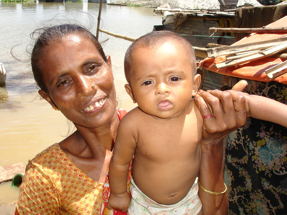 A mother holds her child in Ashulia, northern Dhaka.