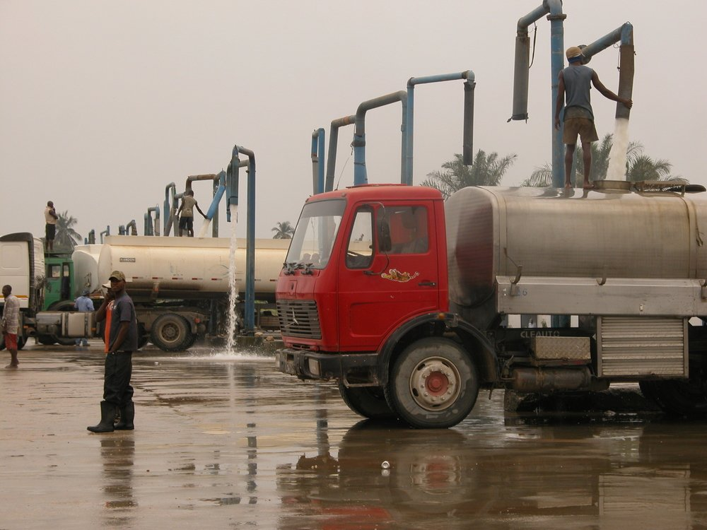 Tankers fill up at the private sector-run water pumping station in Kifangondo, outside the Angolan capital, Luanda.