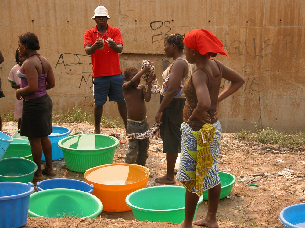 Most Luanda residents buy their water by the bucket.